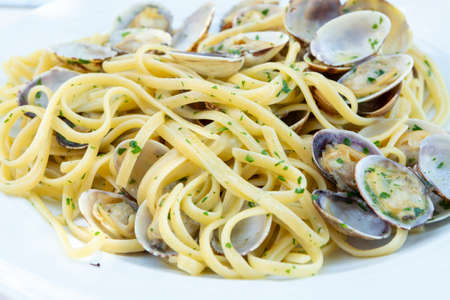 Traditional Italian seafood, spaghetti vongole made with seashells and linguini pasta