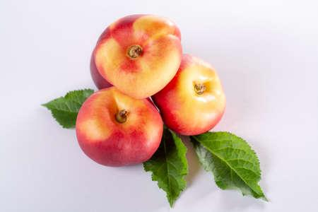 New hybrid sweet fruit nectarina platerina, flat Saturn or donut nectarine peaches close up
