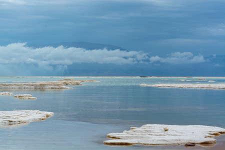 Lowest salty lake in world below sea level Dead sea, full of minerals near luxury vacation resort Ein Bokek
