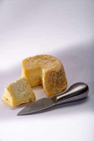 French AOC Langres soft cow crumbly cheese with washed rind structure made in Champagne-Ardenne region Фото со стока