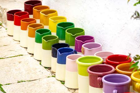 Rows with colorful glazed ceramic jars, flower pots, vases for sale 版權商用圖片