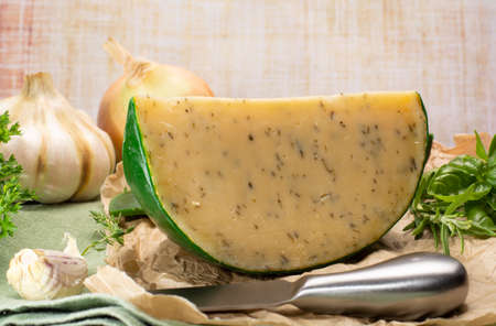 Dutch specialty hard cheese made from cows milk with different spices and fresh green herbs