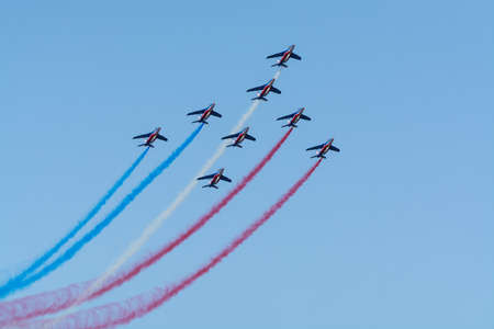 Toulon, FRANCE - August 15, 2018: Patrouille de France aerobatics team, famous demonstration of French Air force, Alpha jets of Patrouille de France in full formation. Editorial
