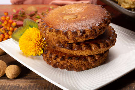 Round Dutch homemade cookies filled with marzipan and almonds nuts, autumn and winter seasonal dessert in Netherlands