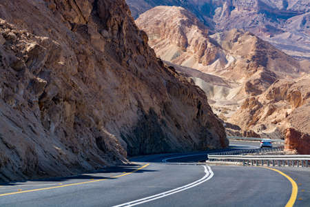 Asphalt road in desert Negev, Israel, road 40, transport infrastructure in desert, scenic mountains route from Eilat to north of Israel