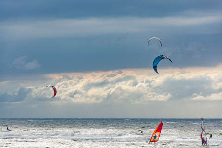 Seascape, North sea by Dutch coast with  kite and wind surfers in winter Sajtókép