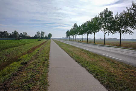 Road network in Netherlands, high quality roads in countryside, landscape with fields, road and separate bicycle line