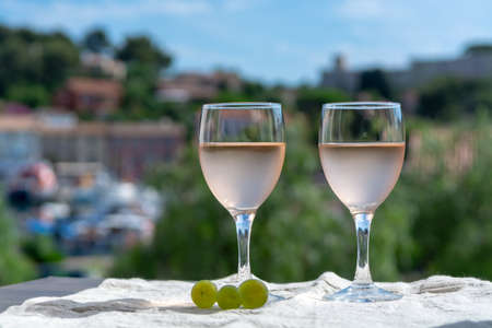 Rose wine of Provence, France, served cold on outdoor terrace in two wine glasses in sunny day