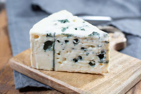Roquefort, soft French cheese made from sheep milk on south of France, one of the world's best known blue cheeses with blue mold