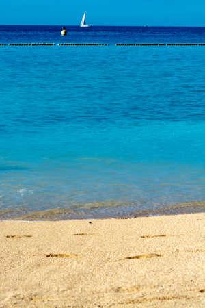 Winter sun travel destination, warm blue ocean swim water on Amadores beach, Gran Canaria, Canary islands, Spain