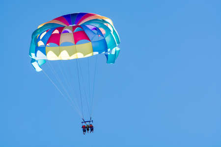 Sea and beach sport for tourists, parasailing in blue sky copy space Standard-Bild