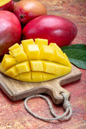 National fruit of India, Pakistan, and Philippines tropical organic ripe red mango ready to eat close up