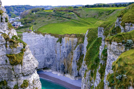 Landscape with scenic alabaster chalk cliffs of Etretat and coast of Atlantic ocean, travel and vacation destination in Normandy, France
