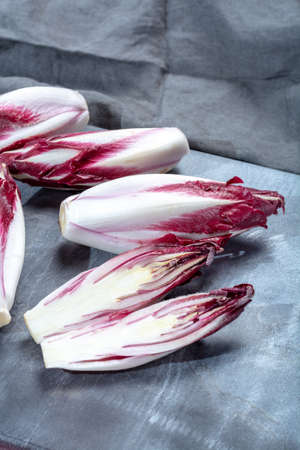 Group of fresh red Radicchio chicory or Belgian endive vegetables, also known as witlof salade, close up Archivio Fotografico