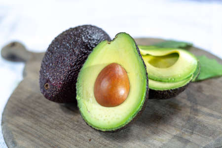 Two fresh ripe raw hass avocados, close up, healthy food concept