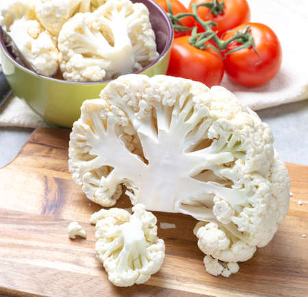 Healthy vegetarian food concept, raw cauliflower white cabbage ready for cooking