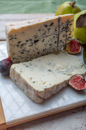 Gorgonzola picant and dolce Italian blue cheese, made from unskimmed cow's milk in North of Italy served with fresh figs and pears