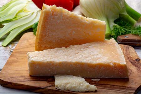 Original italian cheese, aged Parmesan cow milk cheese, pieces of Parmigiano-Reggiano close up Archivio Fotografico
