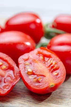 Vine of fresh ripe red cherry prunella tomates close up