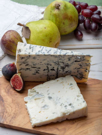 Gorgonzola picant and dolce Italian blue cheese, made from unskimmed cows milk in North of Italy served with fresh figs and pears