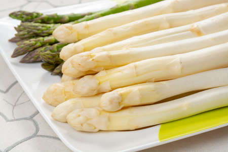 New harvest of white and green asparagus vegetable in spring season, washed asparagus ready to cook, spring menu for restaurants close up Фото со стока