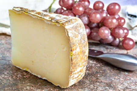 Piece of tasty Ossau-Iraty or Esquirrou sheep cheese produced in south-western France, Northern Basque Country Stock Photo