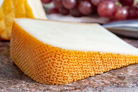 Pieces of french yellow cheeses, Pur Brebis sheep melk cheese fron Pyrenees and Saint Paulin creamy, mild, semi-soft French cheese from pasteurized cow milk Standard-Bild - 119740512
