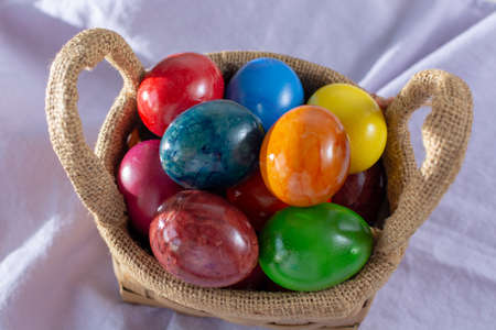 Cooked chicken eggs for Ester celebration dinner, colorful painted with organic paint ready to eat close up