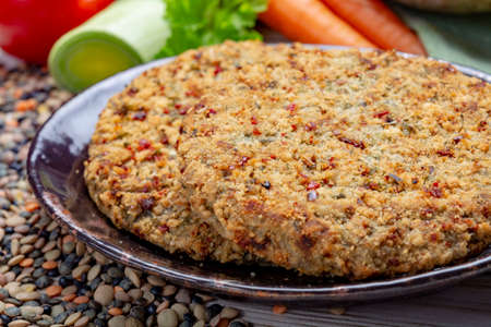 Tasty vegetarian food, raw burgers made from lentils legumes with vegetables ready for cooking, good for vegans