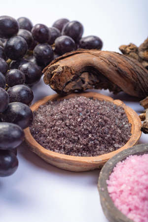 Spa treatment and skin care with Malvasia vulcanic grape aromatic sea salt, close up 版權商用圖片