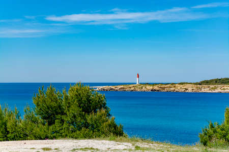 Crystal clear blue water of  Mediterranean sea on St.Croix Martigues sandy beach, Provence, France