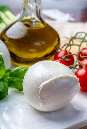 Balls of buffalo mozzarella, soft Italian scheese made from the milk of Italian Mediterranean buffalo close up 版權商用圖片