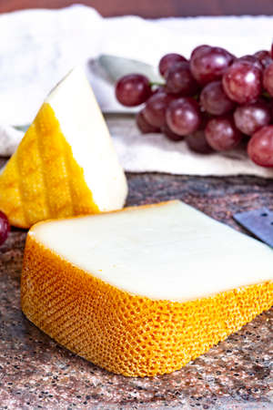 Pieces of french yellow cheeses, Pur Brebis sheep melk cheese fron Pyrenees and Saint Paulin creamy, mild, semi-soft French cheese from pasteurized cow milk Banco de Imagens