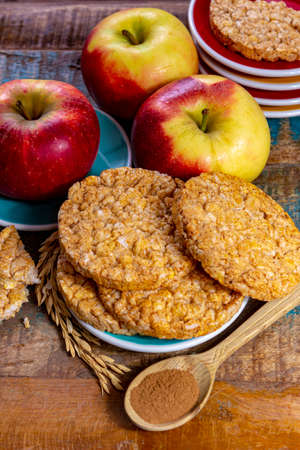 Round rice crackers made with apple and cinnamon, healthy snack for breakfast, lunch and school food close up Stock Photo
