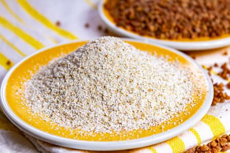 Healthy diet superfood buckwheat groats and flour used for making delicious pasta, noodles, pancaces and kasha in many countries close up