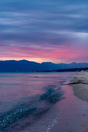 Scenic pink-red sunrise over coastline with sandy beach and clear sea water in Alcamo Marina, small town in Sicily, Italy, summer vacation destination Reklamní fotografie