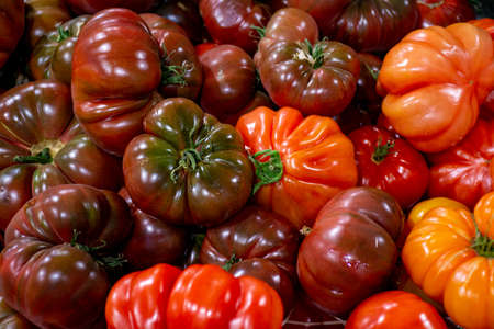 Big ripe french tomatoes, food background close up