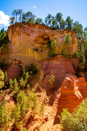 Large colorful ochre deposits, located in Roussillon, small Provensal town in  Natural Regional Park of Luberon, South of France, pigment for paint 写真素材