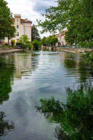 Tourist and vacation destination, view on small Provencal town lIsle-sur-la-Sorgue with green water of Sotgue river, South of France 写真素材