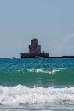 Scenic view on old tower in fort and historical castle in ancient picturesque town Methoni on Peloponnese, Greece, tourist destination