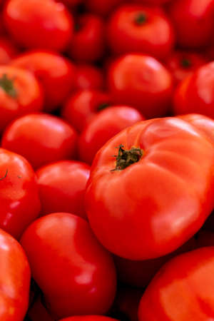 Red ripe tomatoes on farmets market close up, healthy vegetarian food background