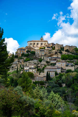 View on Provencal ancient town Gordes, tourists and vacation destination in South of France