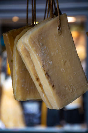 Hand made from natural ingredients and oils soap cutted from blocks hanging in shop, Provence, South of France, close up Reklamní fotografie
