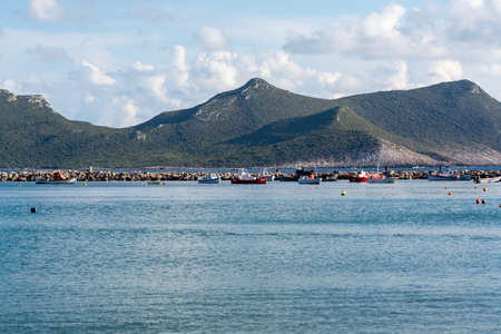 Seascape with sea harbor with clear blue water and traditional colorful greek fisher boats in sunny day Stock Photo - 124905879