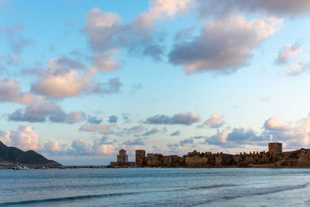 Scenic view on ancient town Methoni on Peloponnese, Greece with old fort and historical castle, tourist destination