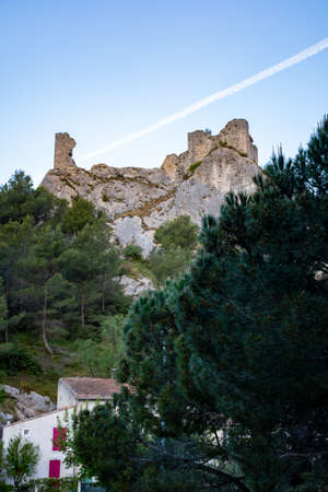View on medieval houses and castle ruines in Provence in sunny day, South of France, vacation and tourist destination