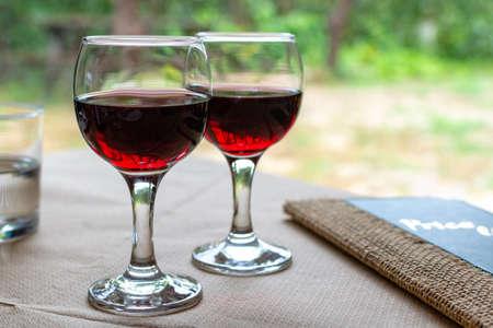Red greek wine is glass from Nemea region, wine tasting, close up