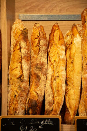 Freshly baked traditional baguettes and bread in small rustic bakery in Provence, South of France, close up 写真素材