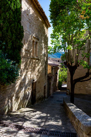 View on traditional and medieval houses in Provence in sunny day, South of France, vacation and tourist destination