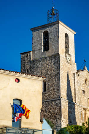 View on traditional and medieval houses and church tower in Provence in sunny day, South of France, vacation and tourist destination